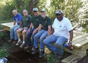 Vernon Greenways Volunteers and their new bridge.