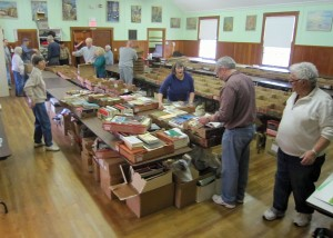Sorting books for the Vernon Historical Society's annual sale.